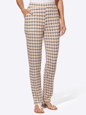 Jersey pantalon - apricot/wit bedrukt